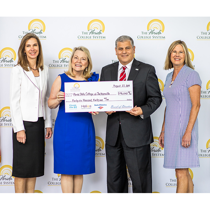 Florida College System Presents Check for Student Scholarships