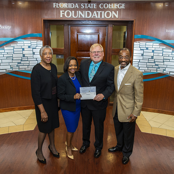 Florida College System Presents Check for Student Scholarship